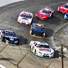 John P. Cleary | The Herald Bulletin<br /> Raphael Lessard in car #51, far left, uses the outside line off of turn four to pass Greg Van Alst during the running of the Redbud 400 Saturday evening at Anderson Speedway. Lessard went on to win the annual race after taking the lead with 32 laps to go.