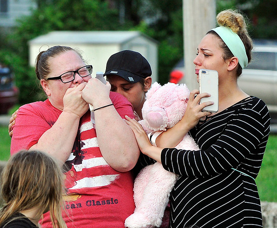 John P. Cleary | The Herald Bulletin<br /> Kailyn Morgan, right, comforts the grandmother of Paisley Hudson after they released balloons to honor memory of Harlan Haines, Caridie Wisler, and Paisley during a vigil Monday evening.