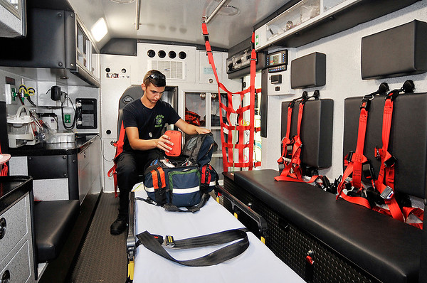 John P. Cleary | The Herald Bulletin<br /> Richland Township Volunteer Fire Department ambulance driver and firefighter Alec Ballousa checks items in a medical bag in the department's new ambulance. Richland Township Volunteer Fire Department now is a Advanced Life Support provider with their ambulance service.