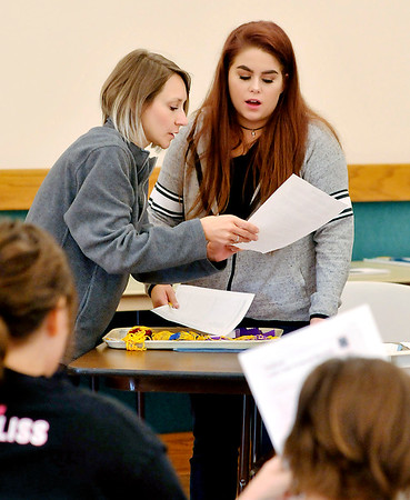 John P. Cleary | The Herald Bulletin<br /> Madison County Purdue Extension 4-H youth development extension educator, Crystal Clark, confers with Caitlin Gibson as 4-H kids wait to be called up to have their Shooting Sports and Sportfishing projects judged this past week.