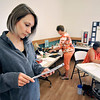 John P. Cleary | The Herald Bulletin<br /> Madison County Purdue Extension 4-H youth development extension educator, Crystal Clark, checks the paperwork for 4-H projects as they are being judged this past week at the 4-H fair grounds.
