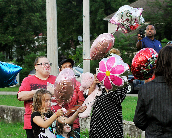 John P. Cleary   The Herald Bulletin<br /> Balloons were released by family and friends of Harlan Haines, Paisley Hudson, and Caridie Wisler to honor their memory Monday evening during a vigil held at Athletic Park.