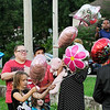 John P. Cleary | The Herald Bulletin<br /> Balloons were released by family and friends of Harlan Haines, Paisley Hudson, and Caridie Wisler to honor their memory Monday evening during a vigil held at Athletic Park.