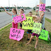 Don Knight | The Herald Bulletin<br /> From left, Kyndall Carmack, Katana Kirk, Aiden-Joe Hammers, Samirah Kirk and Blade Kirk wave to passing motorists during a car wash fundraiser.
