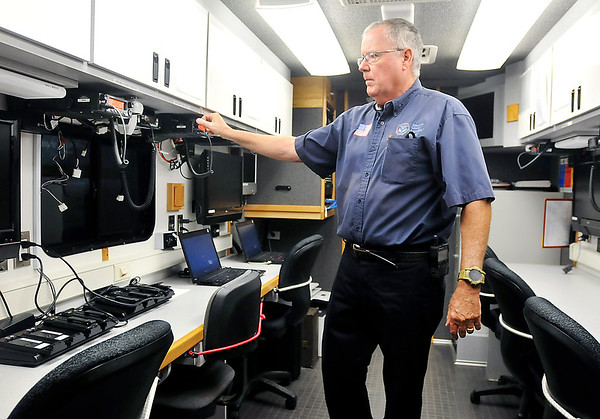 John P. Cleary | The Herald Bulletin <br /> Tom Ecker is the executive director of the Madison County Emergency Management Agency. For Hometown Heroes series. Here Tom turns on the radios in the EMA mobile command center vehicle.