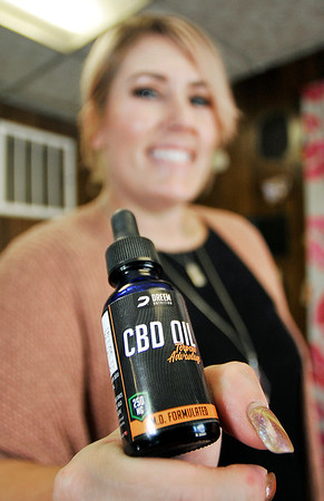 John P. Cleary   The Herald Bulletin <br /> Morgan Johns takes CBD oil and used to sell it at her shop, Rebellious Make Up by Morgan, in Elwood.