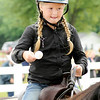 Don Knight | The Herald Bulletin<br /> Genna Bradnick competes in the junior egg race during the Horse and Pony show at the 4-H Fair on Saturday. Competitors balance an egg on a spoon while riding their horse and are eliminated if they drop their egg.