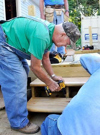 John P. Cleary   The Herald Bulletin<br /> Sy Veneskey is a longtime volunteer with Habitat for Humanity, working on this house being built in Chesterfield.