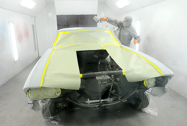 Don Knight | The Herald Bulletin<br /> Kevin Richardson shoots a coat of primer on a '69 Chevelle at American Classics Restoration.
