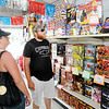 Don Knight | The Herald Bulletin<br /> From left, Madison Ebgreen, Terrie Christoff and Desmond Christoff shop for fireworks at Richie's Firworks in Chesterfield.
