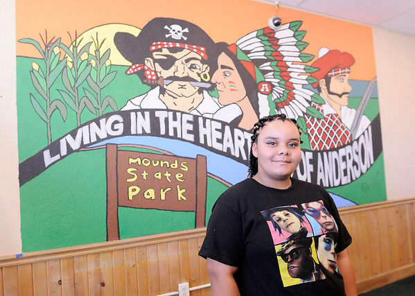 Don Knight   The Herald Bulletin<br /> Anderson High School student Imani Bush submitted the winning design for a mural at Mancino's in Anderson. New owner Jeff Malicki held the mural contest for Anderson students because he felt the restaurant needed an update and a more local feel.