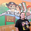 Don Knight | The Herald Bulletin<br /> Anderson High School student Imani Bush submitted the winning design for a mural at Mancino's in Anderson. New owner Jeff Malicki held the mural contest for Anderson students because he felt the restaurant needed an update and a more local feel.