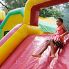 Don Knight | The Herald Bulletin<br /> Nehemiah Johnson, 6, runs through an inflatable obstacle course during Pendleton's 4th at the Falls celebration on Wednesday.