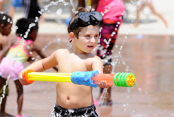 Don Knight   The Herald Bulletin<br /> Jaxton Slaven plays with a water gun while keeping cool at the Daleville splash pad on Saturday.