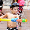 Don Knight | The Herald Bulletin<br /> Jaxton Slaven plays with a water gun while keeping cool at the Daleville splash pad on Saturday.