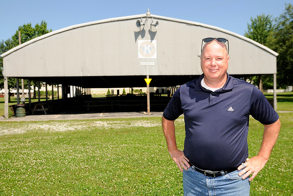 Don Knight | The Herald Bulletin<br /> Rick Davidson in front of two buildings built by Kiwanis and donated to Beulah Park in Alexandria. The local service organization has sponsored and hosted the 4-H Fair since its inception in 1929.