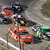 John P. Cleary | The Herald Bulletin<br /> Number 71, Johnny VanDoorn passes Jon Beach out of turn four as Dalton Armstrong follows VanDoorn's line during the Redbud 400.