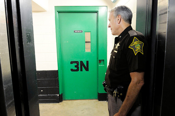 Don Knight | The Herald Bulletin<br /> Sheriff Scott Mellinger takes a moment to talk to an inmate at the jail on Wednesday. The county is looking at short and long term solutions for overcrowding at the jail.