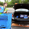 John P. Cleary | The Herald Bulletin<br /> Phillip Thomas, Walmart pickup employee, loads Christy Jones car with her E-shopping order Saturday.