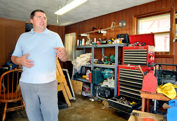 John P. Cleary | The Herald Bulletin<br /> Chris Johnson has seen crime increase in his normally quiet neighborhood on the east side of Anderson. Johnson talks about catching a suspect  in his garage going through his tool chest.