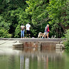 John P. Cleary | The Herald Bulletin<br /> The path around Shadyside Park was a popular place for folks to get out and enjoy the warm afternoon, whether walking the dogs or watching the flow of Killbuck Creek next to the lake. The temperatures are predicted to be below normal for over the weekend.