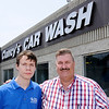 Don Knight | The Herald Bulletin<br /> William Lantz, right, from the Hopewell Center works with Cody Bennett, left, helping him integrate into the work environment at Clancy's Car Wash.