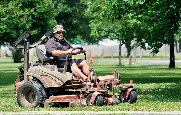 John P. Cleary | The Herald Bulletin<br /> As caretakers of Beulah Park, one of the big items that keeps the Hoschouer's busy is keeping the 16-acre park mowed, which is about an eight hour job.