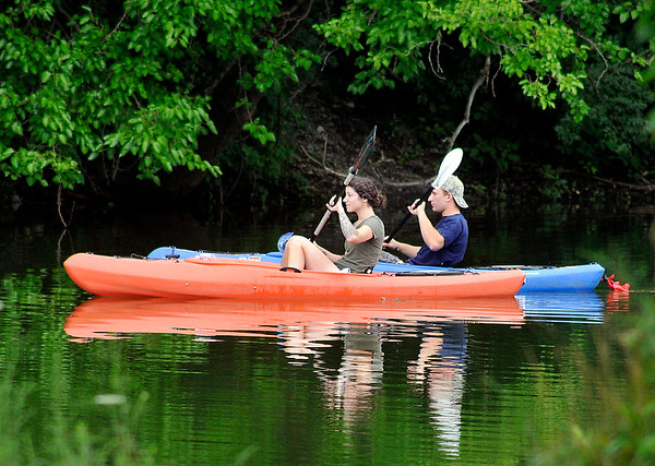 John P. Cleary   The Herald Bulletin<br /> This couple seem to paddle in unison as they maneuver their kayaks around Shadyside Park Monday afternoon enjoying one of the few summer days so far that the temperature has been below the average high for the date, reaching only the mid-70's.