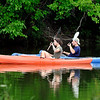 John P. Cleary | The Herald Bulletin<br /> This couple seem to paddle in unison as they maneuver their kayaks around Shadyside Park Monday afternoon enjoying one of the few summer days so far that the temperature has been below the average high for the date, reaching only the mid-70's.