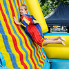 Don Knight | The Herald Bulletin<br /> Ethan Tannas, 9, throws himself at in inflatable hook-and-loop wall during Pendleton's 4th at the Falls celebration on Wednesday.