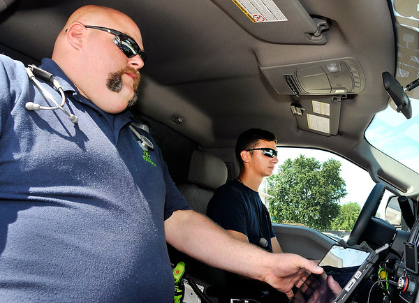 John P. Cleary   The Herald Bulletin<br /> Richland Township Volunteer Fire Department Advanced EMT John Moore and ambulance driver/firefighter Alec Ballousa prepare for their next call.<br /> Richland Township Volunteer Fire Department now is a Advanced Life Support provider with their ambulance service.