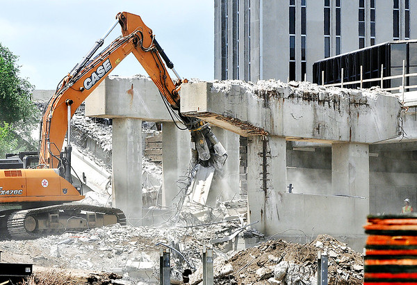 John P. Cleary | The Herald Bulletin<br /> Demolition has now started on the east-bound lanes of the Eisenhower Bridge since the new north side section was open to traffic late last week. Four spans of the old lanes have already been knocked down.