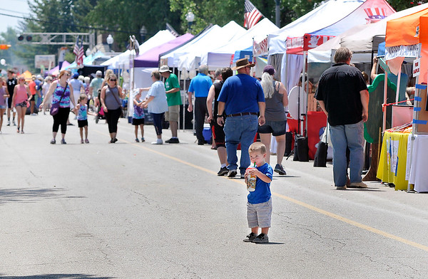 John P. Cleary | The Herald Bulletin<br /> Craft and food booths lined Main Street through Lapel for the annual Lapel Village Fair.
