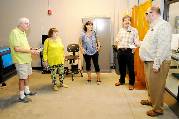 Don Knight | The Herald Bulletin<br /> From left, Bob and Mary Jackson and Tamara Nicolosi talk to Ric Dwenger and Corey Sharp about the Makerspace at Purdue Polytechnic during an open house on Friday.