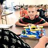 John P. Cleary | The Herald Bulletin<br /> Luke Peercy, of the Grand Champion 4-H Club, listens to 4-H Judge Sharon Albean as she asks questions and makes comments about his beginning Construction Toys project during judging Wednesday at the 4-H Exhibit Hall. Project judging has been going on this week in advance of the start of the 4-H Fair next week.