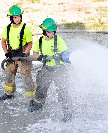 John P. Cleary | The Herald Bulletin<br /> New Anderson Fire Department recruits undergoing training. Here Tanner Williams and Shawn Branch handle the hose as they work with foam and how to spray it.