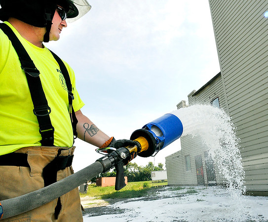 John P. Cleary | The Herald Bulletin<br /> New Anderson Fire Department recruits undergoing training. Here Mick Hart handles the hose nozzle as the recruits work with foam.