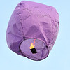 John P. Cleary | The Herald Bulletin<br /> One of the lanterns floats up in the sky during a vigil to honor memory of Harlan Haines, Paisley Hudson, and Caridie Wisler Monday evening.