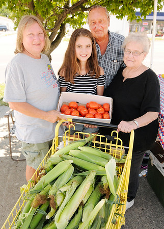 Don Knight | The Herald Bulletin<br /> From left, Tami Hazelbaker, Madi Gray, Dallace Hazelbaker and Sandy Hazelbaker run a family farm stand on Broadway in Anderson.