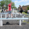 Don Knight | The Herald Bulletin<br /> Evan Peterson balances on a pole while trying out the AFJROTC obstacle course on Thursday. Incoming students were taking part in a three-day Cadet Leadership Course.