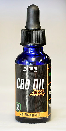 John P. Cleary | The Herald Bulletin <br /> Morgan Johns takes CBD oil and used to sell it at her shop, Rebellious Make Up by Morgan, in Elwood.