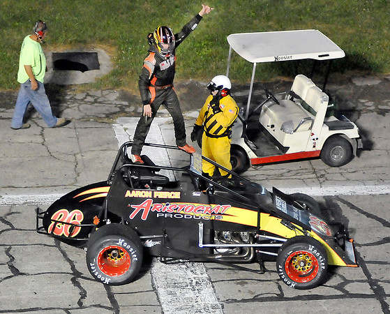 John P. Cleary | The Herald Bulletin<br /> Aaron Pierce stands on his sprint car and gives the fans a wave after winning the 75-lap non-winged sprint car feature at Anderson Speeedway as part of Thursday Night Thunder racing.