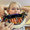 John P. Cleary | The Herald Bulletin<br /> Haiden Jones, 7, tries on the beard she's made for the Build a Beard competition during the annual Lapel Village Fair.