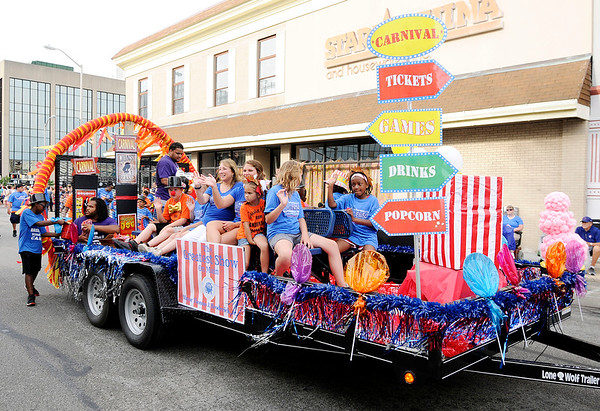 Don Knight   The Herald Bulletin<br /> The Parks Department decorated their float in a carnival theme for Anderson's Independence Day Parade on Tuesday.