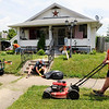 Don Knight | The Herald Bulletin<br /> Andrew Caplinger mows as volunteers from Anderson First Church of the Nazarene canvassed the neighborhood around the church looking to get to know their neighbors and lend a helping hand as part of Mission Anderson. Their efforts continue Saturday morning by picking up large items neighbors want to dispose of but aren't able to, you can reach the church at 765-643-3137 to ask for a pick-up. On Sunday they will cap off Mission Anderson by hosting a block party with the Anderson Police Department from 1 to 3 p.m.