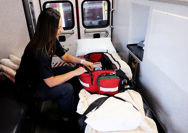 Don Knight   The Herald Bulletin<br /> Paige Creasy checks the equipment on Elwood's ambulance 773. Creasy realized her dream of working for the Elwood Fire Department.