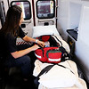 Don Knight | The Herald Bulletin<br /> Paige Creasy checks the equipment on Elwood's ambulance 773. Creasy realized her dream of working for the Elwood Fire Department.