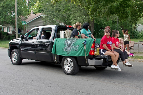 Edgewood Elementary School staff members promote their school during the annual Ollie Dixon Back to School Parade on Saturday. (Mark Maynard photo)