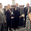 Anderson City Clerk Sheila Ashley performs the swearing in ceremony for new Anderson firefighters Dustin Oliphant, Travis Schweitzer and Thomas Smalls during the Anderson Board of Public Safety meeting.