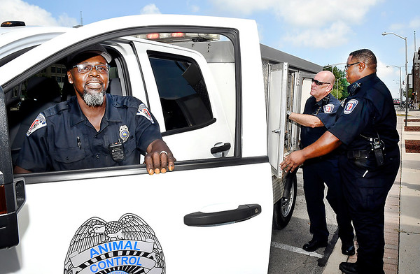John P. Cleary | The Herald Bulletin<br /> Anderson Police Department's Animal Control officer Danny Davis gets out of their new truck as Senior Humane officer Chris Ockomon and Animal Control officer Dennis Watson check the back of the truck with it's climate controlled animal compartments.